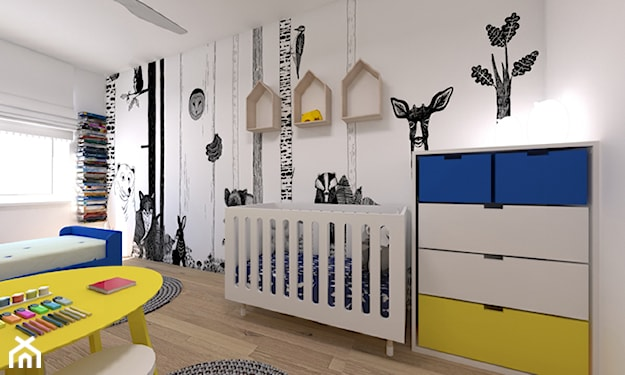 komoda z kolorowymi szufladami, grafiki na ścianie