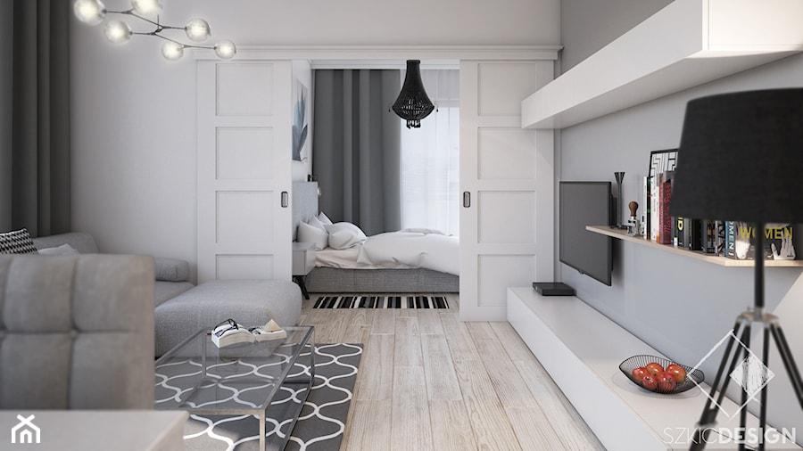 Projekt mieszkania w Płocku - Mały szary salon, styl skandynawski - zdjęcie od Szkic Design - Projektowanie wnętrz