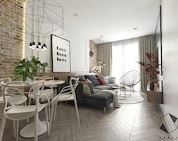 Mieszkanie 8 - Średni szary czarny salon z jadalnią, styl nowoczesny - zdjęcie od BAGUA Pracownia Architektury Wnętrz