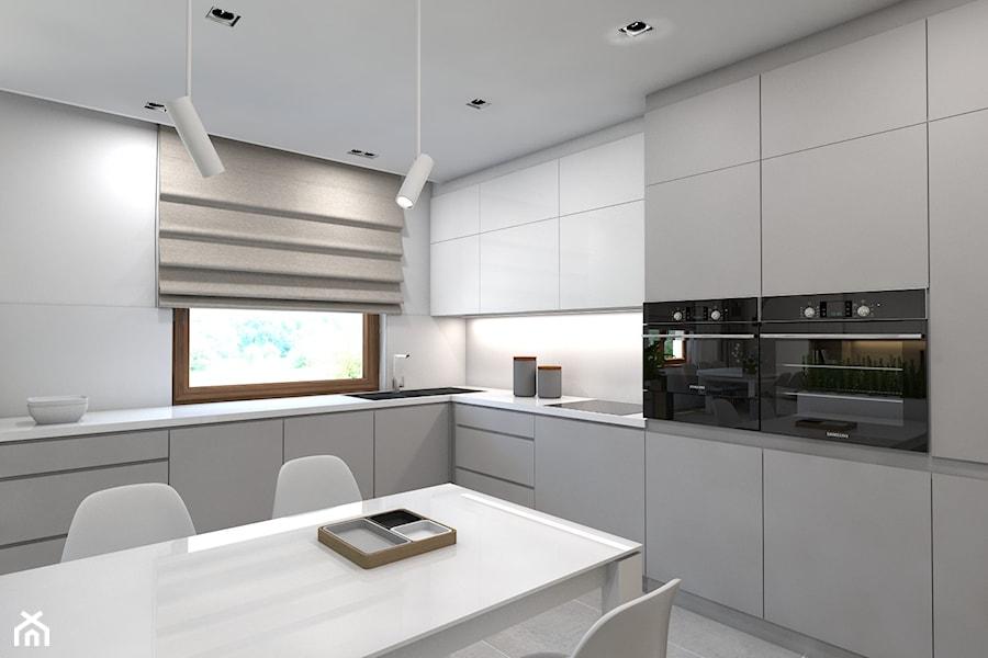 (Dom w okolicy Lublińca) Dom jednorodzinny 7 - Duża otwarta biała kuchnia w kształcie litery l w aneksie, styl nowoczesny - zdjęcie od BAGUA Pracownia Architektury Wnętrz