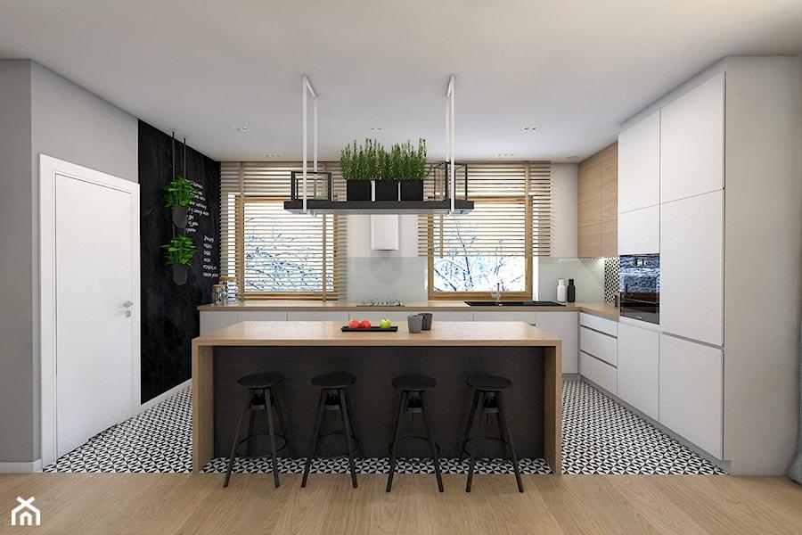 (Sochaczew) Projekt domu jednorodzinnego 8 - Duża otwarta biała czarna kuchnia w kształcie litery l z wyspą, styl skandynawski - zdjęcie od BAGUA Pracownia Architektury Wnętrz