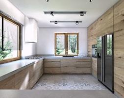 (Będzin) Projekt domu jednorodzinnego 4 - Średnia otwarta biała kuchnia w kształcie litery u w aneksie, styl nowoczesny - zdjęcie od BAGUA Pracownia Architektury Wnętrz