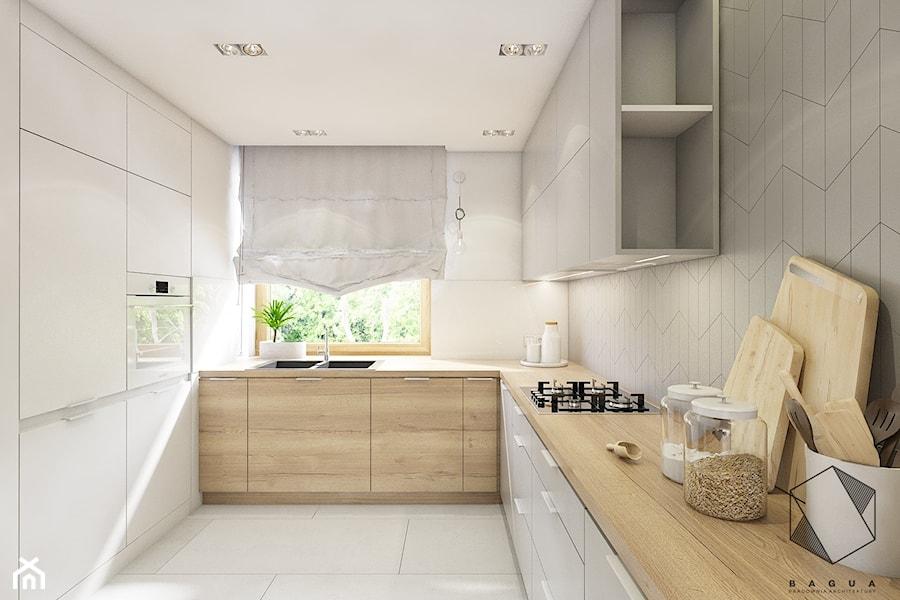 (Dąbrowa Górnicza) Dom jednorodzinny 15 - Średnia zamknięta biała szara kuchnia w kształcie litery l w aneksie z oknem, styl nowoczesny - zdjęcie od BAGUA Pracownia Architektury Wnętrz