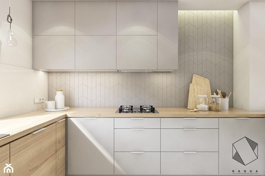 (Dąbrowa Górnicza) Dom jednorodzinny 15 - Mała zamknięta biała szara kuchnia w kształcie litery l z oknem, styl nowoczesny - zdjęcie od BAGUA Pracownia Architektury Wnętrz