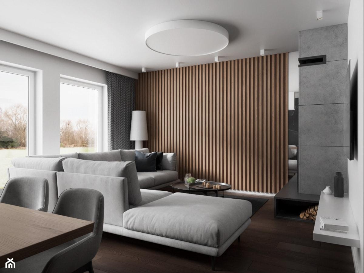 Salon z jadalnią w domu w Pniowie autorstwa pracowni Spacja Studio. - zdjęcie od Spacja Studio - Homebook