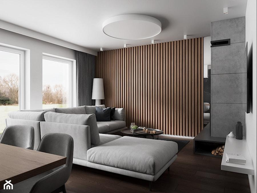 Salon z jadalnią w domu w Pniowie autorstwa pracowni Spacja Studio. - zdjęcie od Spacja Studio