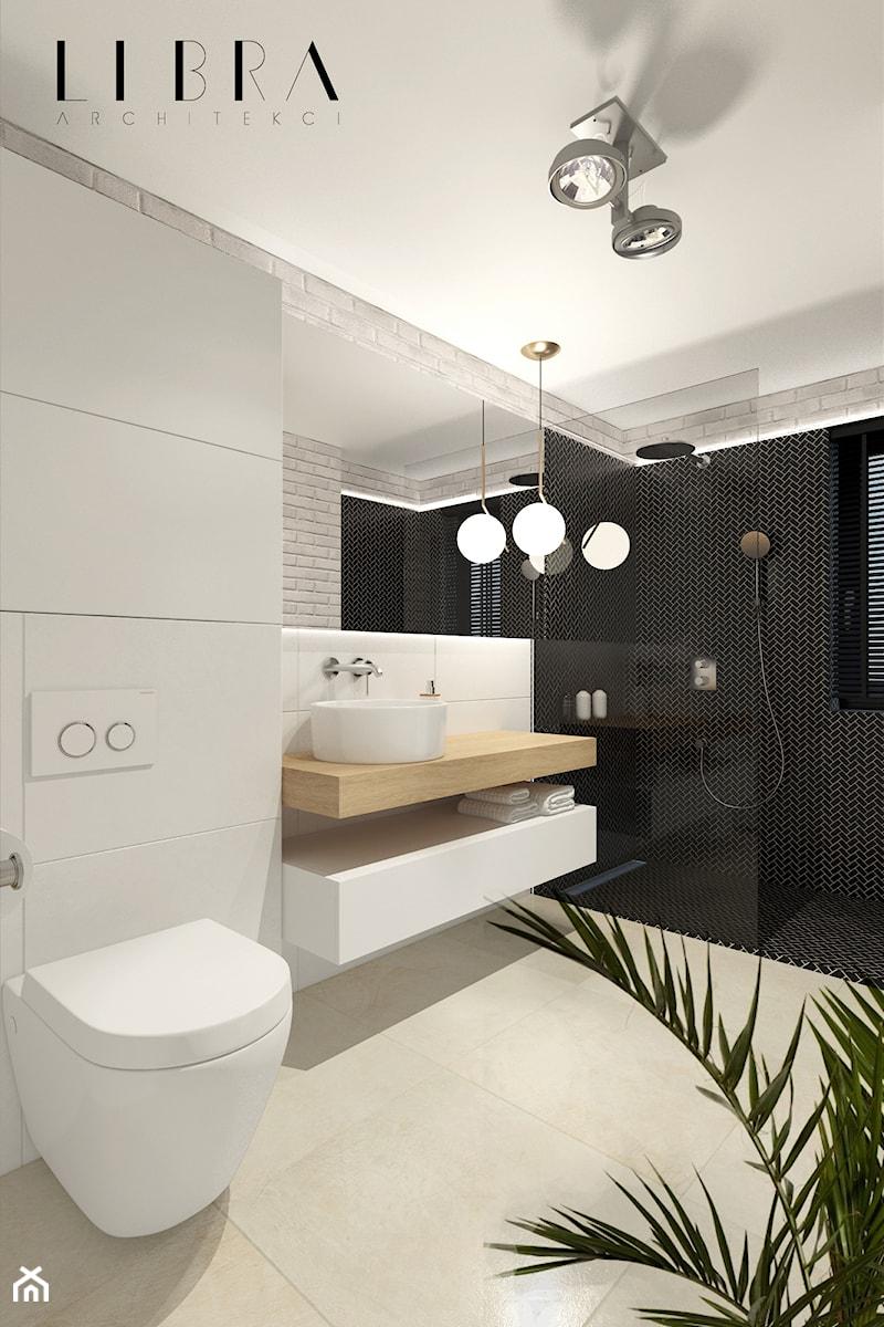 Projekt holu z biurem i toaletą - Mała średnia biała czarna łazienka w bloku z oknem, styl nowoczesny - zdjęcie od LIBRA Architekci
