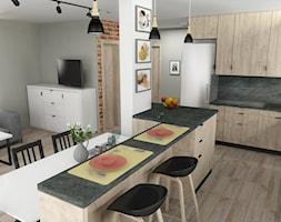 Przestronna kuchnia, z salonem w tle - zdjęcie od Inspirem
