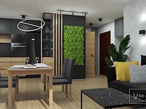 Luksusowe wnętrze wykonane w oparciu o drewno i czerń - 80m2