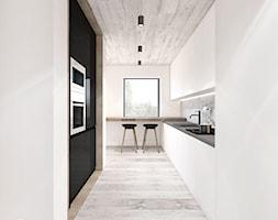 PROJEKT ŁAZIENKI I KUCHNI / GARLICA MUROWANA. - Średnia otwarta wąska biała kuchnia dwurzędowa z oknem, styl industrialny - zdjęcie od MADO DESIGN Projekty Wnętrz - Kraków