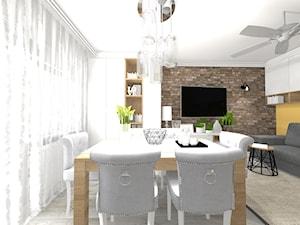 Aranżacja Salonu w Bloku - Mały szary żółty salon z jadalnią, styl skandynawski - zdjęcie od STUDIO WHITE Architektura Wnętrz