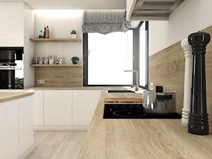 Projekt wnętrz - dom jednorodzinny okolice Poznania - Duża otwarta biała kuchnia w kształcie litery l z wyspą z oknem, styl nowoczesny - zdjęcie od art-park sp. z o.o.