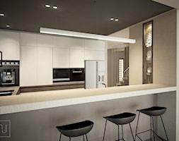 Dom bliźniak - Duża beżowa kuchnia w kształcie litery u w aneksie z wyspą z oknem, styl nowoczesny - zdjęcie od Nela Just ARCHITEKTURA WNĘTRZ