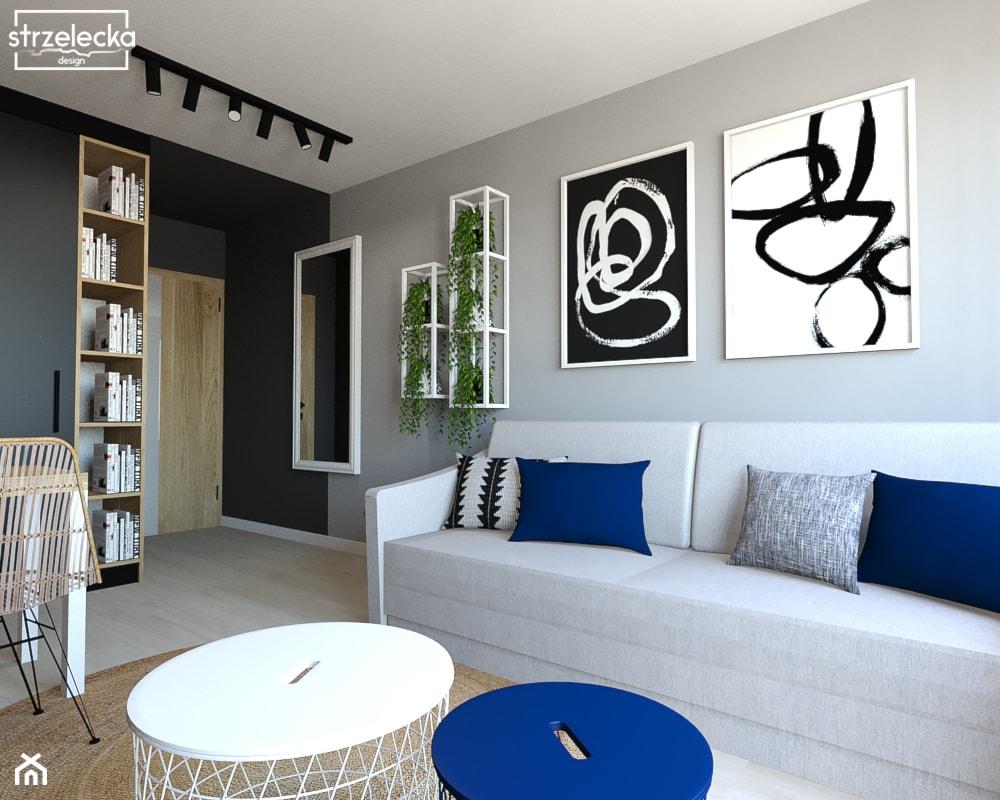 Salon w loftowym klimacie - Mały szary czarny salon z jadalnią, styl nowoczesny - zdjęcie od Strzelecka Design - Homebook