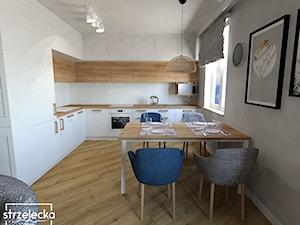 Salon z kuchnią z grantowymi dodatkami