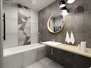 łazienka w betonach i szarościach