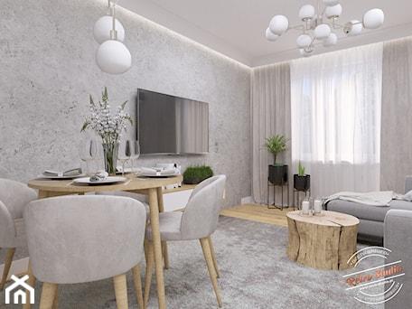 Aranżacje wnętrz - Salon: Mieszkanie 57 m2 - Mały szary biały salon z jadalnią, styl glamour - Retro Studio. Przeglądaj, dodawaj i zapisuj najlepsze zdjęcia, pomysły i inspiracje designerskie. W bazie mamy już prawie milion fotografii!