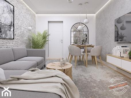 Aranżacje wnętrz - Salon: Mieszkanie 57 m2 - Mały szary biały salon z jadalnią, styl nowojorski - Retro Studio. Przeglądaj, dodawaj i zapisuj najlepsze zdjęcia, pomysły i inspiracje designerskie. W bazie mamy już prawie milion fotografii!