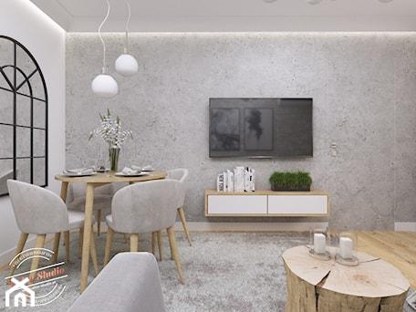 Aranżacje wnętrz - Salon: Mieszkanie 57 m2 - Średni szary biały salon z jadalnią, styl nowoczesny - Retro Studio. Przeglądaj, dodawaj i zapisuj najlepsze zdjęcia, pomysły i inspiracje designerskie. W bazie mamy już prawie milion fotografii!