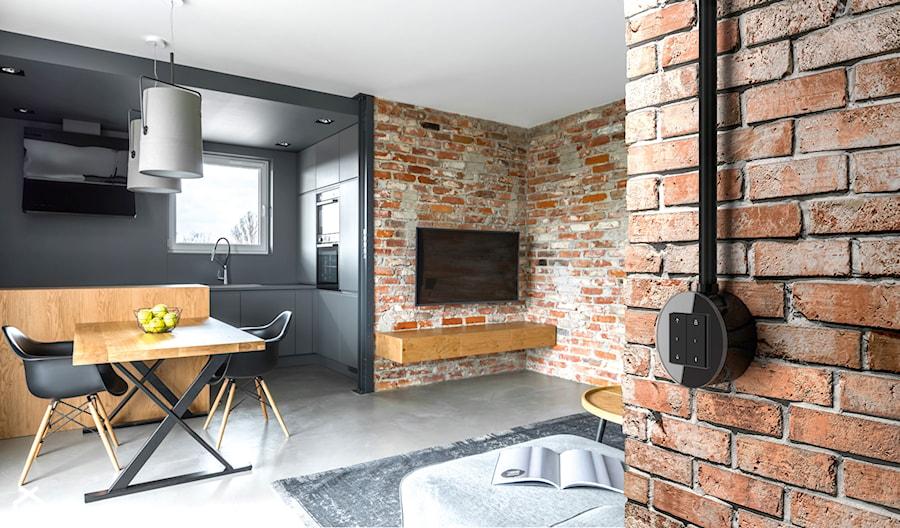 Gira Studio - Salon, styl industrialny - zdjęcie od GIRA - TEMA