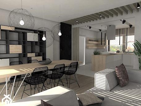 Rzeszów - dom w nawłociach - Duża otwarta żółta jadalnia w kuchni w salonie, styl skandynawski - zdjęcie od Designbox Marta Bednarska-Małek