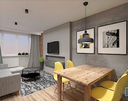 Mieszkanie dla singla - Średnia szara jadalnia w salonie, styl industrialny - zdjęcie od INDOMDESIGN
