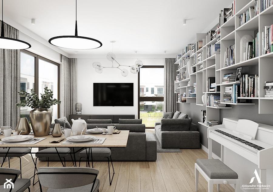 Nova Krolikarnia Mokotow - Średni szary biały salon z bibiloteczką z jadalnią z tarasem / balkonem, styl nowoczesny - zdjęcie od Aleksandra Wachowicz