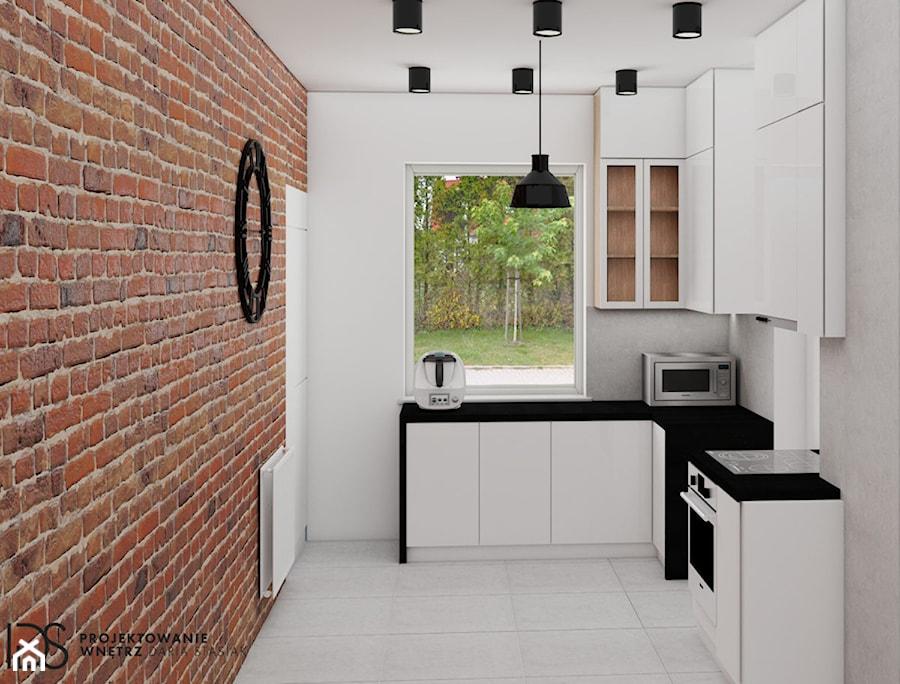 Kuchnia Z Czerwoną Cegłą I Białymi Meblami Zdjęcie Od Ids