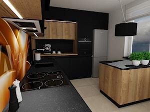 kuchnia 44 - Średnia zamknięta biała czarna kuchnia w kształcie litery l z wyspą z oknem, styl nowoczesny - zdjęcie od projekt ka