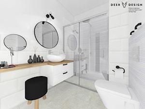 Biała łazienka z czarnymi dodatkami