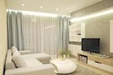 miętowe zasłony, beżowy dywan, futurystyczny stolik o obłym kształcie, kremowy narożnik, białe firany