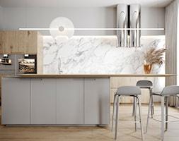 Modern Classic - Duża otwarta biała beżowa kuchnia jednorzędowa dwurzędowa w aneksie z wyspą z oknem, styl nowoczesny - zdjęcie od Homedesignkiev