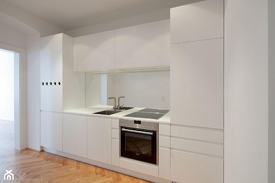 Realizacje - Mała otwarta kuchnia jednorzędowa w aneksie z oknem, styl nowoczesny - zdjęcie od HOSTA MEBLE