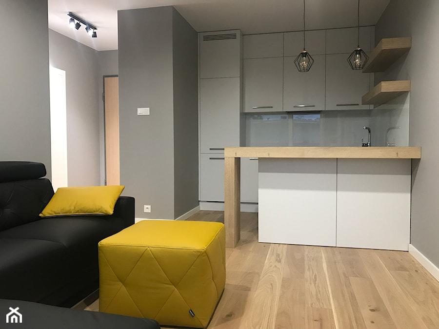 Realizacje - Mała otwarta szara kuchnia w kształcie litery u, styl nowoczesny - zdjęcie od HOSTA MEBLE