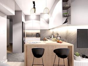 WARSZAWA WOLA - Średnia otwarta biała szara czarna kuchnia w kształcie litery l dwurzędowa w aneksie, styl nowoczesny - zdjęcie od INVENTIVE studio