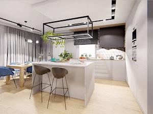 DOM POZNAŃ - Duża otwarta szara kuchnia w kształcie litery l z wyspą z oknem, styl nowoczesny - zdjęcie od INVENTIVE studio