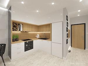 Mieszkanie z różowym akcentem. - Mała otwarta szara kuchnia w kształcie litery l w aneksie, styl skandynawski - zdjęcie od INVENTIVE studio