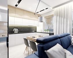 KOBYŁKA - Duża otwarta szara kuchnia w kształcie litery l w aneksie z oknem, styl nowoczesny - zdjęcie od INVENTIVE studio