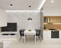 Mieszkanie z różowym akcentem. - Średnia otwarta biała jadalnia w kuchni w salonie, styl skandynawski - zdjęcie od INVENTIVE studio