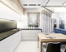 KOBYŁKA - Średnia otwarta szara czarna kuchnia w kształcie litery l w aneksie z oknem, styl nowoczesny - zdjęcie od INVENTIVE studio