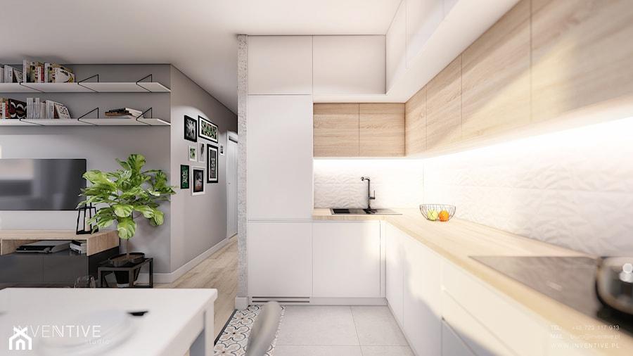 MIESZKANIE KRAKÓW - Średnia otwarta biała szara kuchnia w kształcie litery l w aneksie, styl minimalistyczny - zdjęcie od INVENTIVE studio