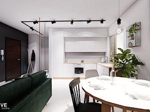GDYNIA - Średnia otwarta biała kuchnia w kształcie litery l w aneksie z oknem, styl minimalistyczny - zdjęcie od INVENTIVE studio