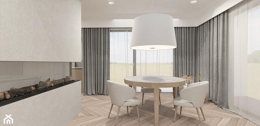 DOM W WILKOWICACH - Średnia otwarta biała jadalnia w salonie - zdjęcie od MANUKA pracownia projektowa