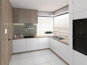 """Wnętrze powtarzalnego projektu """"ANTARA"""". - Średnia zamknięta biała czarna kuchnia w kształcie litery l w aneksie z oknem, styl nowoczesny - zdjęcie od V P S Architektura"""