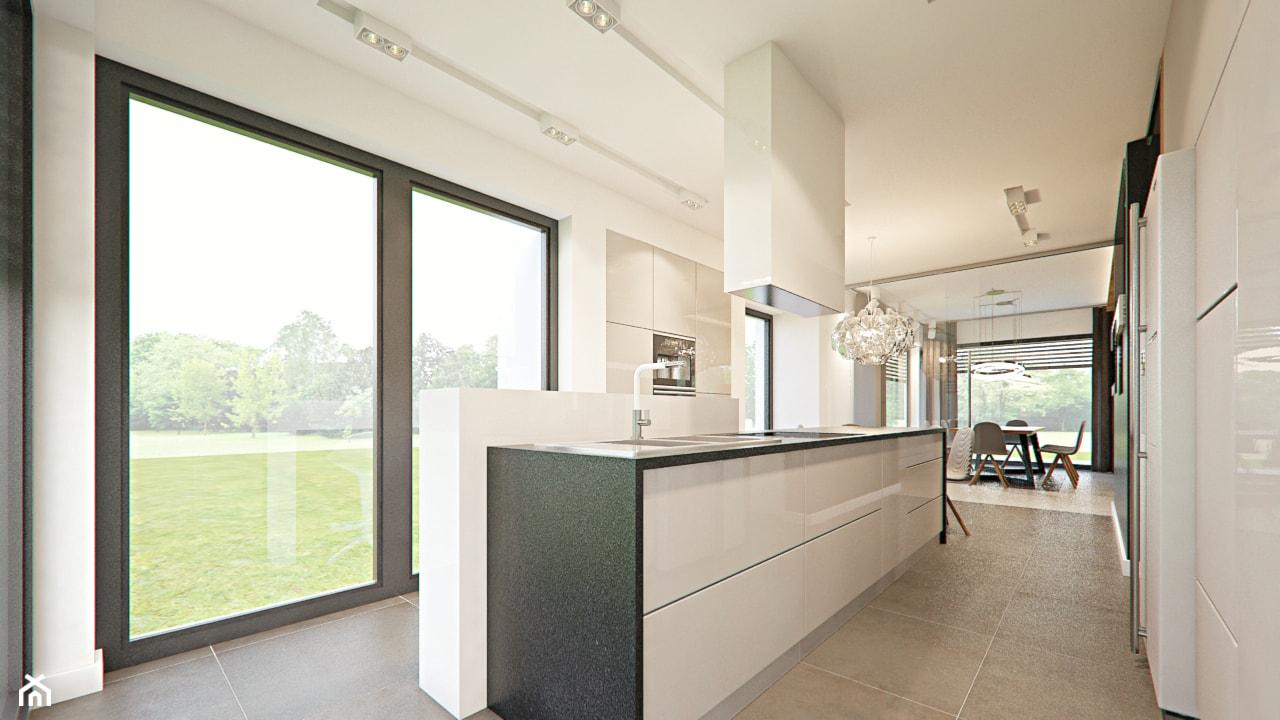 Średnia otwarta biała kuchnia w kształcie litery l dwurzędowa w aneksie z oknem, styl nowoczesny - zdjęcie od SzklarczykDesign - Homebook