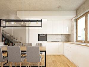 002 - Duża biała szara kuchnia w kształcie litery l w aneksie z oknem, styl industrialny - zdjęcie od SzklarczykDesign