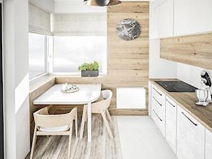 Mała kuchnia z betonowymi frontami