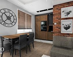 Mieszkanie w stylu loftowym - Średnia otwarta szara jadalnia w kuchni w salonie, styl industrialny - zdjęcie od Bayo design