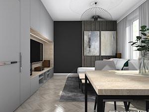 Salon z kuchnią w ciemnych kolorach