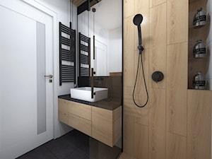Projekt łazienki oraz wc w stylu minimalistycznym i czarna armatura